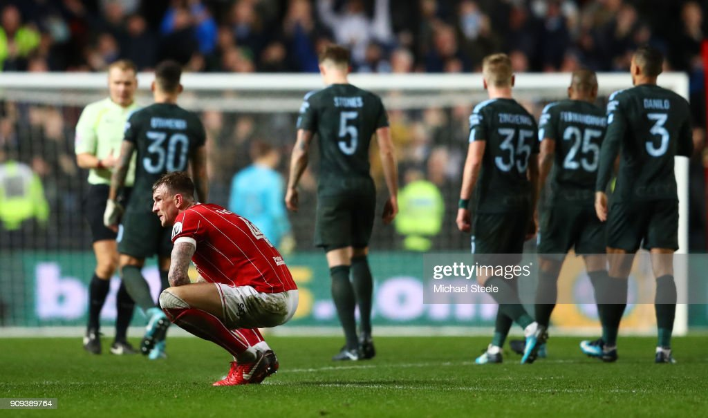 Aden Flint of Bristol City (4) looks dejected in defeat after the Carabao Cup semi-final second leg match between Bristol City and Manchester City at Ashton Gate on January 23, 2018 in Bristol, England.