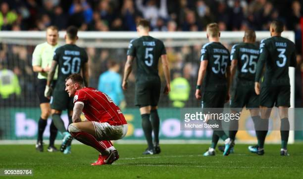 Aden Flint of Bristol City looks dejected in defeat after the Carabao Cup semifinal second leg match between Bristol City and Manchester City at...