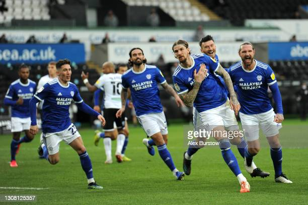 Aden Flint of Cardiff City celebrates with team mates after scoring their side's first goal during the Sky Bet Championship match between Swansea...