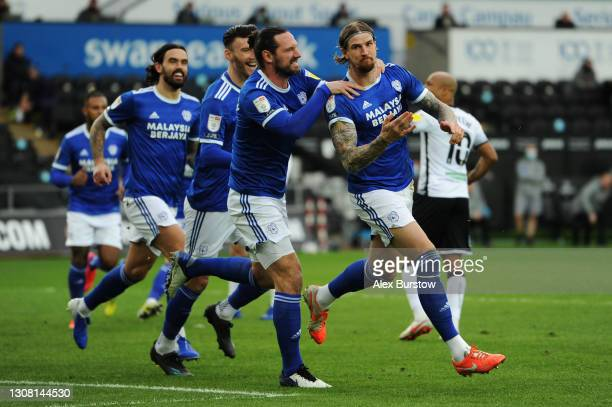 Aden Flint of Cardiff City celebrates with teammate Sean Morrison after scoring their team's first goal during the Sky Bet Championship match between...