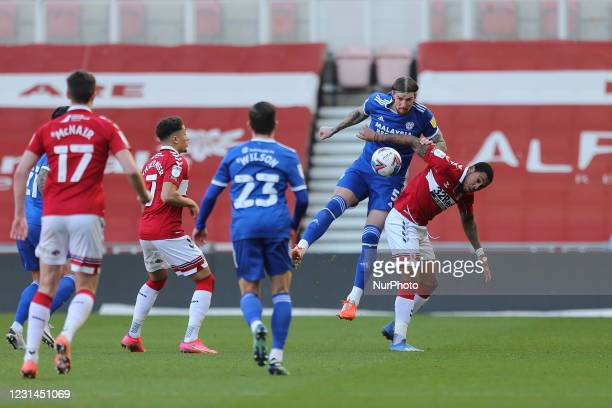 Aden Flint of Cardiff City contests a header with Britt Assombalonga of Middlesbrough during the Sky Bet Championship match between Middlesbrough and...