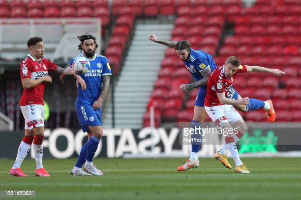 Aden Flint of Cardiff City contests a header with Duncan Watmore of Middlesbrough during the Sky Bet Championship match between Middlesbrough and...