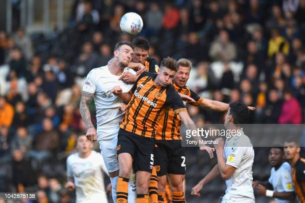 Aden Flint of Middlesbrough is challenged by Reece Burke of Hull City during the Sky Bet Championship match between Hull City and Middlesbrough at...