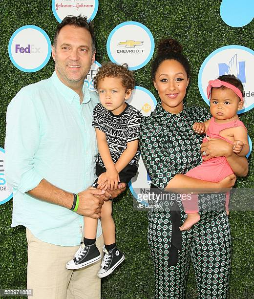 Aden John Tanner Housley Adam Housley and Tamera Mowry attend Safe Kids Day at Smashbox Studios on April 24 2016 in Culver City California