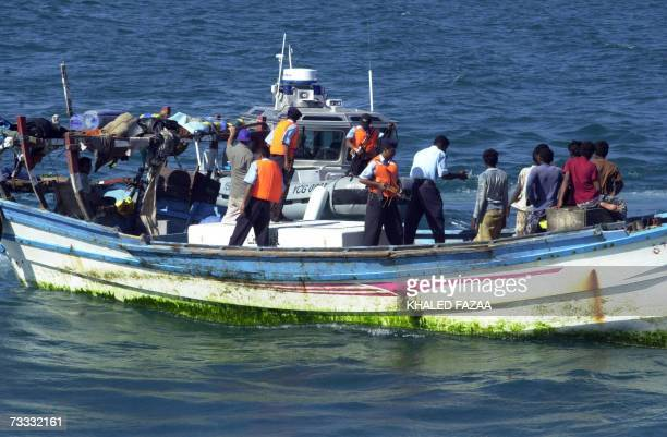 An undated picture shows Yemeni coast guards checking a small boat with refugees arriving from Somalia to the Yemeni port city Aden According to the...