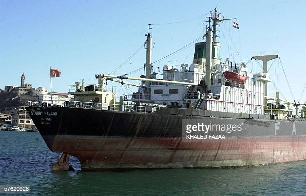 TO GO WITH AFP STORY BY CHRISTIAN CHAISE A Chinese ship waits to unload its cargo in the Red Sea port of Aden 11 May 2006 It is a shadow of its...
