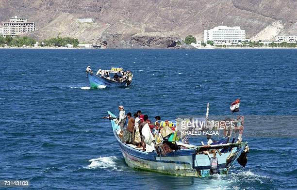 TO GO WITH AFP STORY BY CHRISTIAN CHAISE Yemeni fishermen use motorboats off the coast of the Red Sea port of Aden opposite the city's trade free...