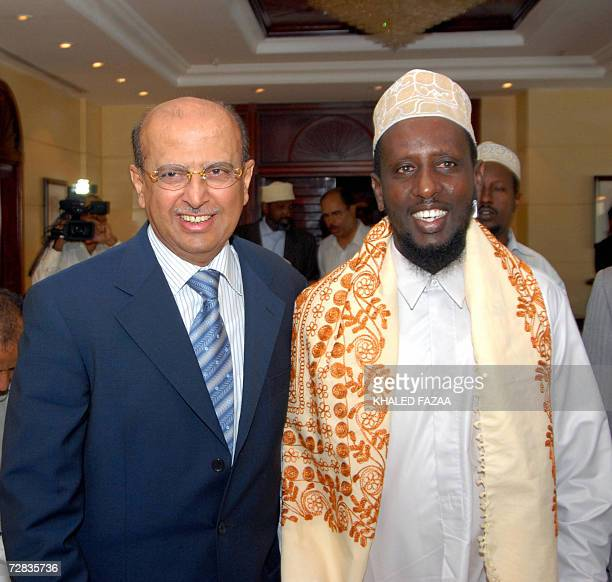 Yemeni Foreign Minister Abu Bakr Abdullah alKurbi poses for a picture with Sheikh Sharif Sheikh Ahmed head of the Somali Islamic courts at the end of...