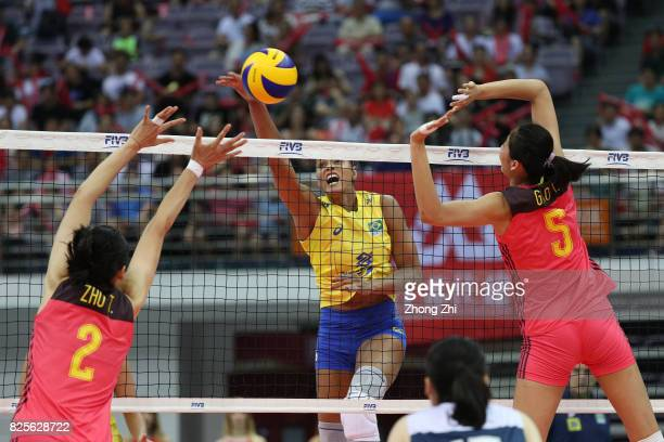 Adenizia Da Silva of Brazil in action against Ting Zhu and Yi Gao of China during the match between China and Brazil during Day 1 of 2017 Nanjing...