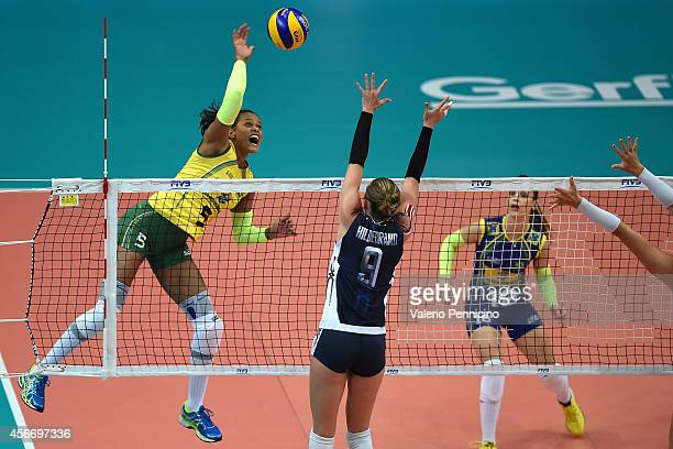 Adenizia Silva of Brazil spikes as Kristin Lynn Hildebrand of USA blocks the FIVB Women's World Championship pool F match between Brazil and USA on...