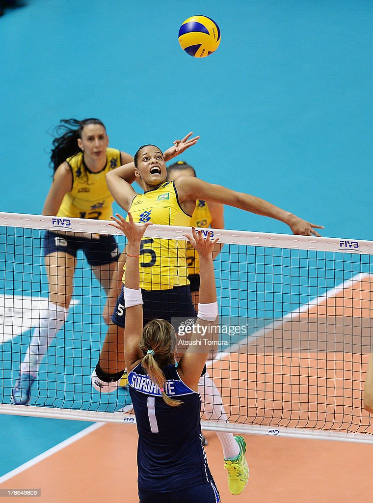 Adenizia Silva of Brazil spikes the ball during day three of the FIVB World Grand Prix Sapporo 2013 match between Brazil and Italy at Hokkaido Prefectural Sports Center on August 30, 2013 in Sapporo, Hokkaido, Japan.