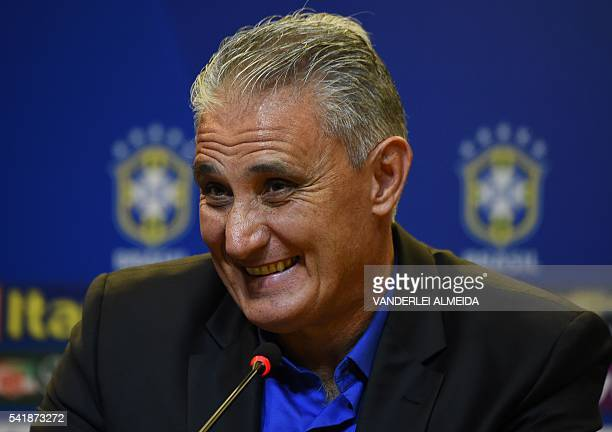 Adenor Leonardo Bacchi known as Tite smiles during a press conference after being appointment by the Brazilian Football Confederation as the new...