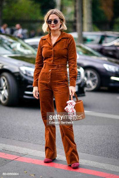 Adenorah wears a brown suit outside the Lemaire show during Paris Fashion Week Womenswear Spring/Summer 2018 on September 27 2017 in Paris France