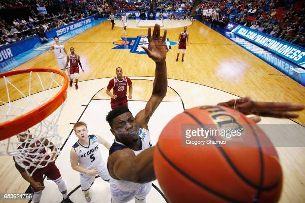 T Adenrele of the UC Davis Aggies blocks a shot by Pablo Rivas of the North Carolina Central Eagles in the second half during the First Four game in...
