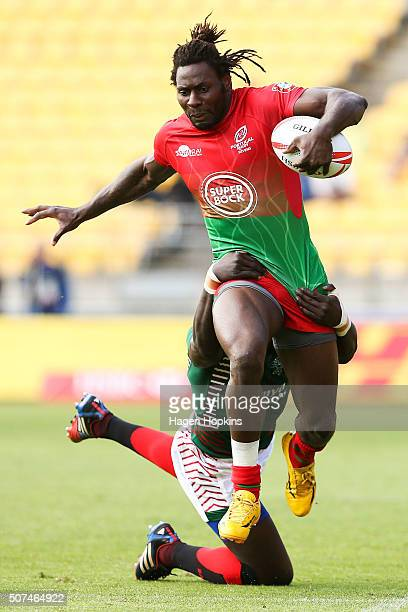 Aderito Esteves of Portugal is tackled by Oscar Ouma of Kenya during the 2016 Wellington Sevens pool match between Kenya and Portugal at Westpac...