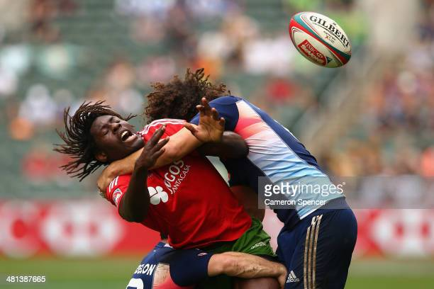 Aderito Esteves of Portugal is tackled high during the Bowl quarterfinal match between France and Portugal during the 2014 Hong Kong Sevens at Hong...
