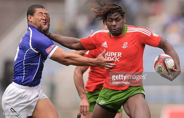 Aderito Esteves of Portugal palms off Paul Perez of Samoa during the match between Samoa and Portugal during day one of the Tokyo Sevens at Prince...