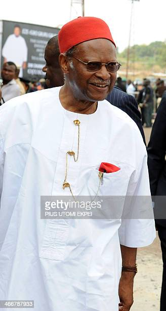 Aderogba Obisesa This picture taken on March 1 2012 former Commonwealth SecretaryGeneral Emeka Anyaoku wears his red fezlike hat widely worn by males...
