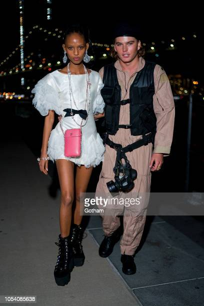 Adesuwa Aighewi and Jordan Barrett attend the V Magazine Halloween Party presented by Chanel at Jane's Carousel on October 26 2018 in Brooklyn New...