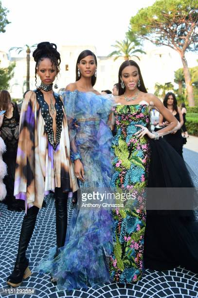 Adesuwa Aighewi, Cindy Bruna and Winnie Harlow attend the amfAR Cannes Gala 2019 at Hotel du Cap-Eden-Roc on May 23, 2019 in Cap d'Antibes, France.