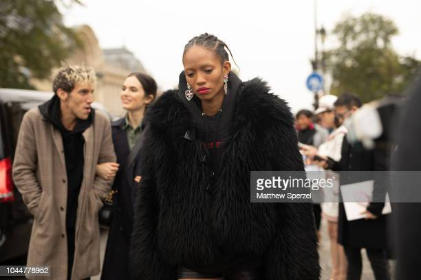 Adesuwa Aighewi is seen on the street during Paris Fashion Week SS19 wearing Chanel on October 2 2018 in Paris France