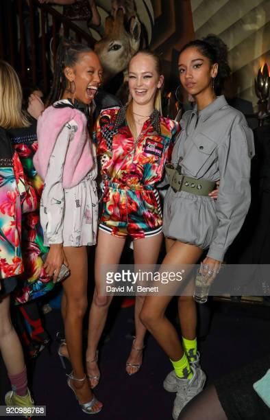 Adesuwa Aighewi Jean Campbell and Aden Curtiss at LOVE and MIU MIU Women's Tales Party at Loulou's on February 19 2018 in London England