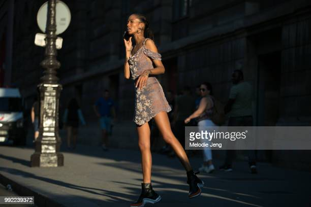 Adesuwa Aighewi talks on the phone and looks for her driver after Alexandre Vauthier during the Couture Fall 2018 shows on July 3 2018 in Paris France