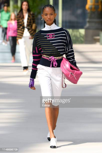 Adesuwa Aighewi walks the runway during Chanel Cruise 2020 Collection at Le Grand Palais on May 3 2019 in Paris France