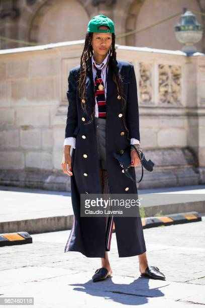 Adesuwa Aighewi wearing Thom Browne long coat and grey shorts is seen in the streets of Paris before the Thom Browne show during Paris Men's Fashion...