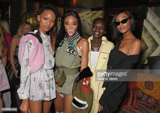 Adesuwa Aighewi Winnie Harlow Achok and Jourdan Dunn attends the LOVE and MIU MIU Women's Tales Party at Loulou's on February 19 2018 in London...