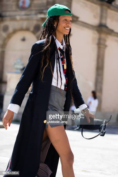 Adesuwa Aighewi with a Thom Browne dog bag at Thom Browne during Paris Fashion Week Men's Spring/Summre 2019 on June 23 2018 in Paris France