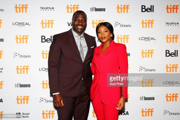 Adewale AkinnuoyeAgbaje and Genevieve Nnaji attend the 'Farming' premiere during 2018 Toronto International Film Festival at Scotiabank Theatre on...