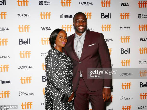 Adewale AkinnuoyeAgbaje and guest attend the 'Farming' premiere during 2018 Toronto International Film Festival at Scotiabank Theatre on September 8...