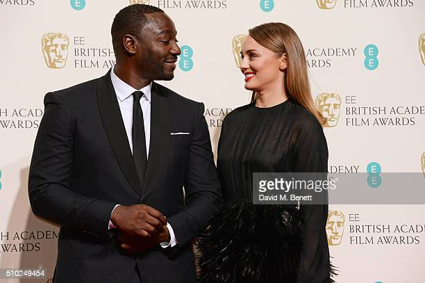 Adewale AkinnuoyeAgbaje and Laura Haddock pose in the winners room at the EE British Academy Film Awards at The Royal Opera House on February 14 2016...
