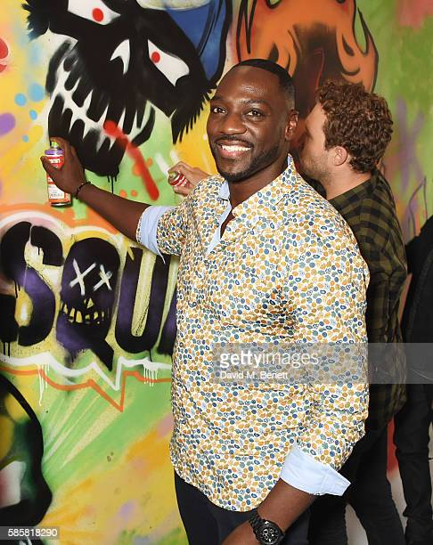 """Adewale Akinnuoye-Agbaje and the cast of """"Suicide Squad"""" put the finishing touches on Graffiti artist Ryan Meades' mural ahead of tomorrow's film..."""
