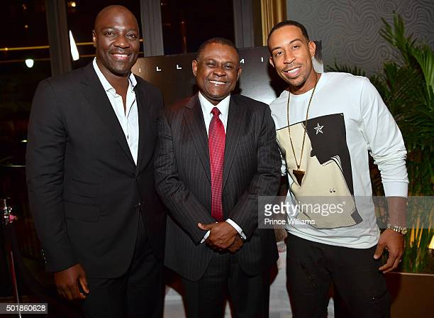 Adewale AkinnuoyeAgbaje Dr Bennet Omalu and Ludacris attend the Concussion Atlanta Screening at Cinebistro Town Brookhaven on December 17 2015 in...