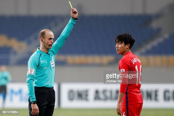 Adham Mohammad Makhadmeh referee of Jordan gives yellow card to Jang Yunho of South Korea during AFC U23 Championship Quarterfinal between South...