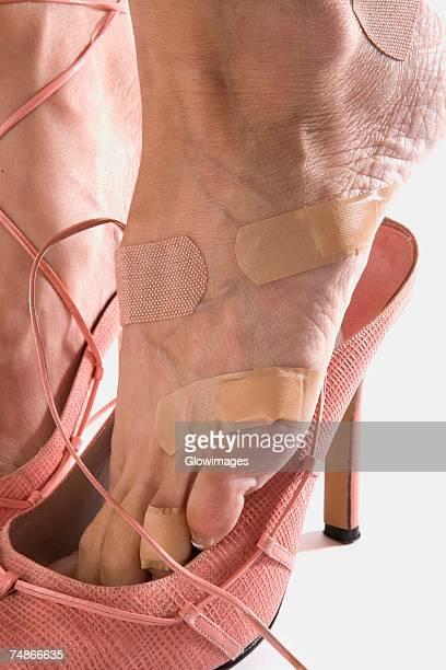 Adhesive bandage on a woman's foot
