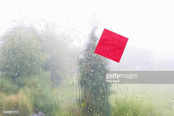adhesive note stuck to window summer