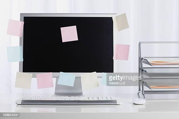 Adhesive notes stuck to computer monitor