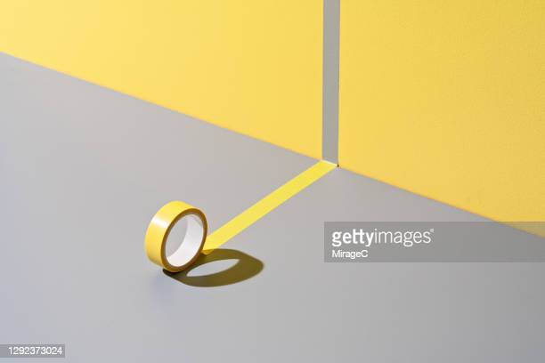adhesive tape sticking to yellow and gray - 文房具 ストックフォトと画像