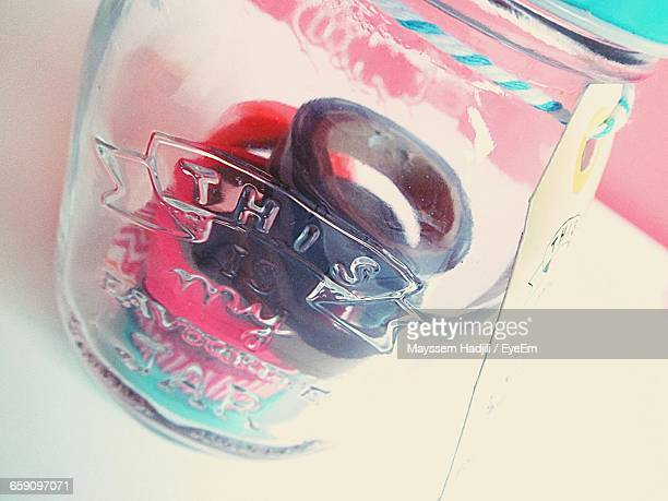 Adhesive Tapes Seen Through Glass Container On Table