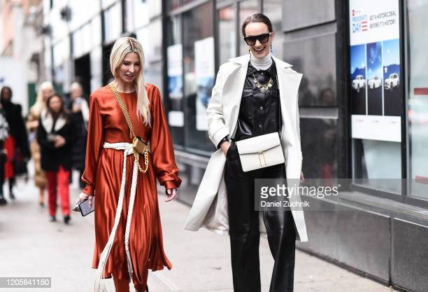 Adi Heyman and Olivia Perez are seen outside the Coach 1941 show during New York Fashion Week: A/W20 on February 11, 2020 in New York City.