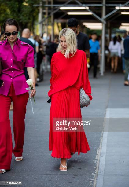 Adi Heyman is seen wearing wearing red knit, pleated skirt outside Brock Collection during New York Fashion Week September 2019 on September 11, 2019...