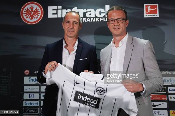 Adi Huetter poses with Fredi Bobic during his presentation as new head coach of Eintracht Frankfurt at CommerzbankArena on May 30 2018 in Frankfurt...