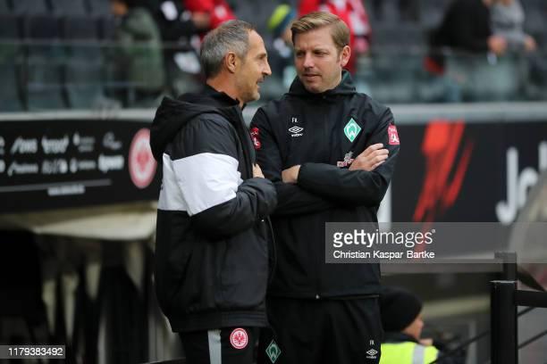 Adi Hutter Head Coach of Eintracht Frankfurt and Florian Kohfeldt Head Coach of SV Werder Bremen talk prior to the Bundesliga match between Eintracht...