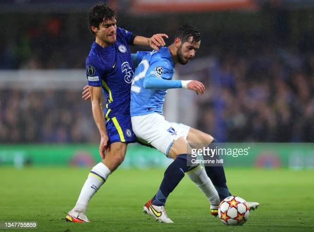 Adi Nalic of Malmo FF holds off Marcos Alonso of Chelsea during the UEFA Champions League group H match between Chelsea FC and Malmo FF at Stamford...