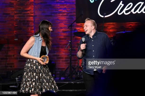 Adi Neumann and Branden Harvey the Community Giver award winner speak onstage during Nashville Creator Awards hosted by WeWork at Marathon Music...