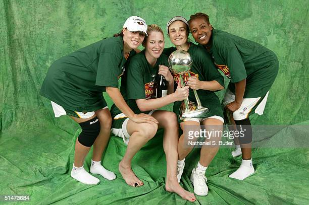 Adia Barnes Lauren Jackson Tully Bevilaqua and Sheri Sam of the Seattle Storm pose for a portrait with the WNBA Championship Trophy after defeating...