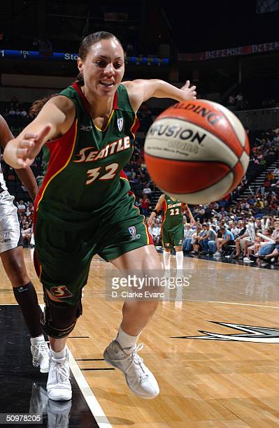Adia Barnes of the Seattle Storm attempts to save the ball from going out of bounds against the San Antonio Silver Stars on June 19 2004 at the SBC...